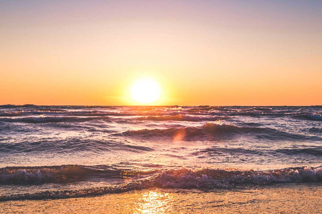 Scenic view of ocean during sunset